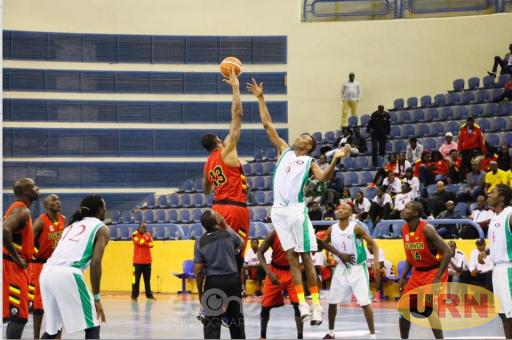 Ugandas Darius Pegues goes for the ball in a game againts Burundi