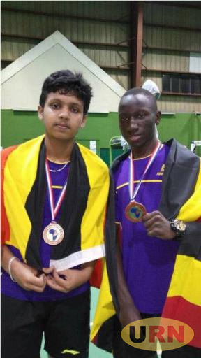Expedito Emuddu and Arshath Mohamad Vaheed after winning gold medals in Mauritius yesterday.