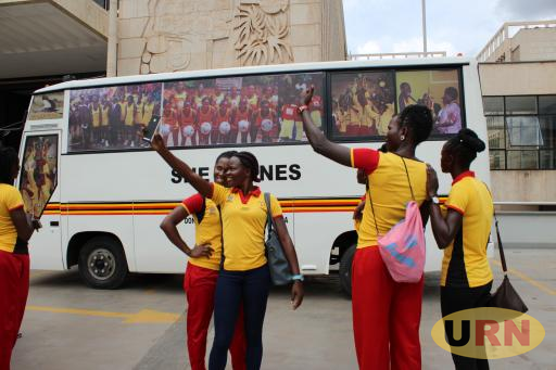 Uganda She Cranes players take a selfie near the Isuzu bus.