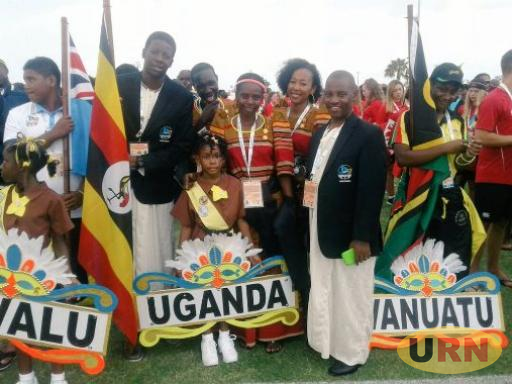 Nuwagaba (right with a jacket) was head of Uganda's delegation to the Bahamas for the 2017 World Youth Games.