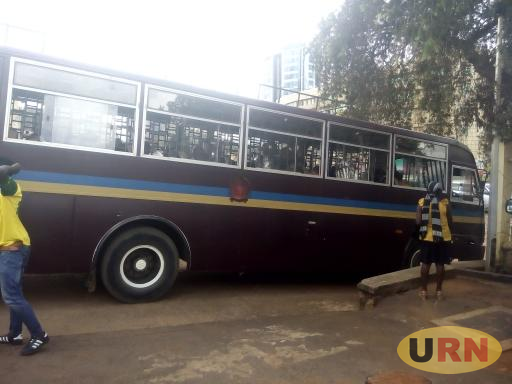 A bus taking back prisoners who were brought at Buganda Road Court
