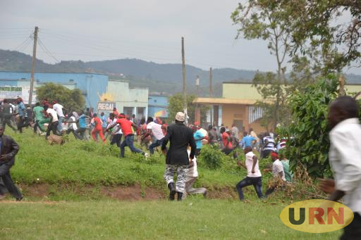 FDC supporters running away after the police started shooting at them.