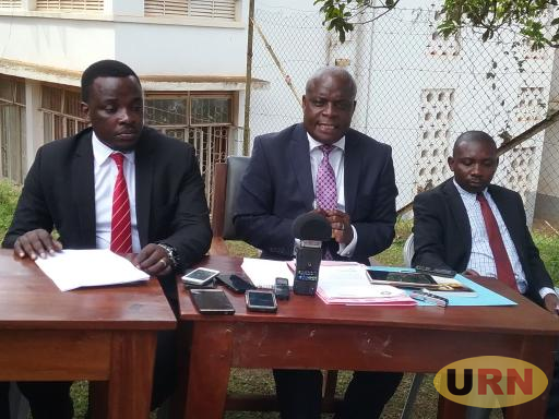 Samuel Munobe Masaka chief magistrate middle with other magistrates during a news conference