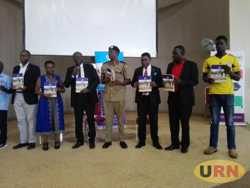 Muhammed Ndifuna, the CHief Executive Officer of Human Rights Network - Uganda launching the November report on Friday.