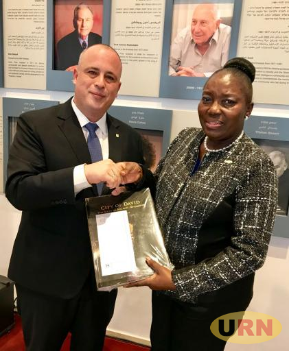 The Deputy Speaker of the Israeli Parliament Yehiel Hilik Bar hands a gift to the Speaker Rebecca Kadaga at the African Speakers seminar in Jerusalem.