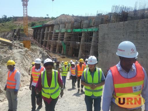 Chairperson of UEGCL Board Eng Proscovia Margaret Njuki (2nd Left) after inspecting challenges identified in the dam and power Intake sections of Karuma.