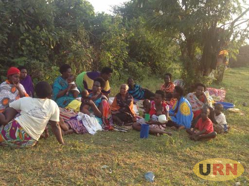 Affected eviction victims next to a scrub where they sleep following burning of their houses