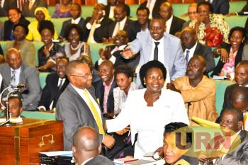 NRM MPs celebrate with Government Chief Whip Ruth Nankabirwa and Raphael Magyezi after passing the Age Limit Bill.