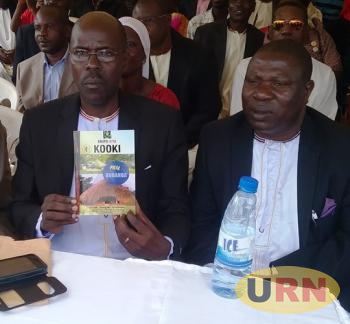 A Kooki official showing one of his latest books which clarifies on the relationship between Buganda and Kooki