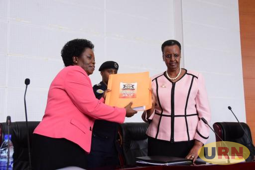 First Lady and Minister of Education Janet Kataaha Museveni receives 2017 PLE results from UNEB Chairperson Prof. Mary Okwakol today.
