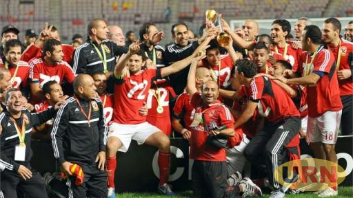 Egypt's Al Ahly team celebrate with the 2013 Champions League trophy.