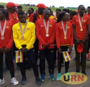 The five medal winners at the just concluded Commonwealth Games on arrival in Entebbe on Thursday.