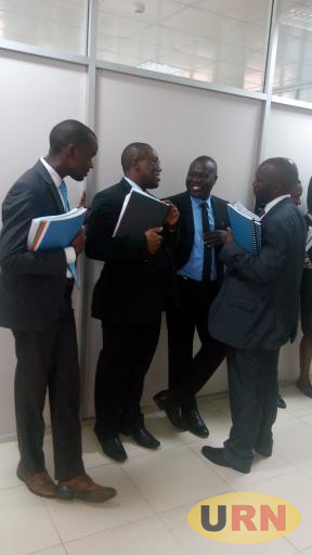 MP Ssekikubo and his lawyers inside court corridors