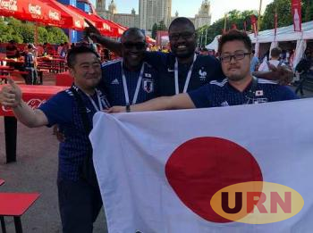 Uganda fans Emmanuel Misagga (SC Villa President) and Ali Sekatawa (Nyabitobora FC owner) with other fans in Russia.