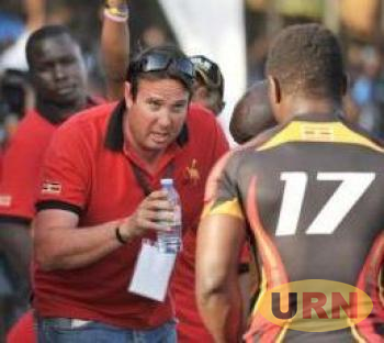 Uganda Rugby Cranes coach John Duncan speaks to a players during a previous game.