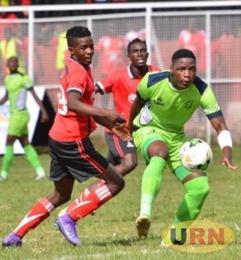 Vipers SC's Milton Karisa (L) battling against Platinum Stars FC (South Africa) last year in the CAF Confederations Cup.