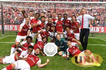 Arsenal Football Club players celebrate a community shield success