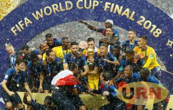 The France team celebrates with the 2018 FIFA World Cup trophy.