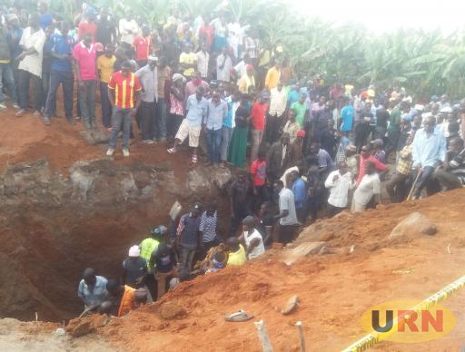 Residents gathering around a pit latrine where Amza Kiiza died from