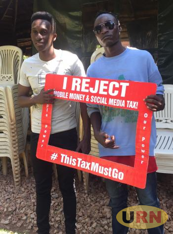 Some youths in a campaign againts mobile money and social media tax