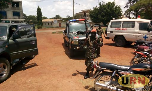 An Escort of Lt. Gen Andrew Gutti Arrives At the Court Session in Gulu District Council Hall