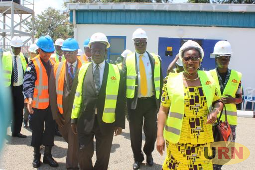 Vice President Edward Kiwanuka Ssekandi and Ministers,  Irene Muloni and Simon Du'janga after he had commissioned the Nkenda-Hoima transmission line and sub station