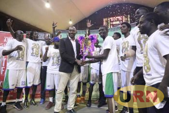 City Oilers led by captain Jimmy Enabu celebrate alongside FUBA President Ambrose Tashobya