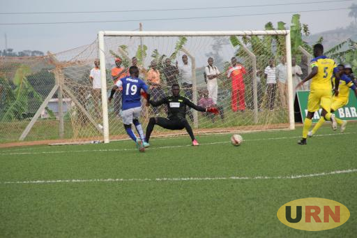 Ndejje players defend themselves as BUL FC seals their win in the second half.