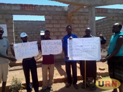Residents of Rupa with placards over land grabbing recently.