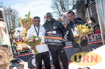 Cheptegei (C) after winning the race in Netherlands on Sunday.