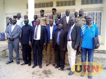 Delegates pose for a group photo after a joint meeting of Uganda - South Sudan authorities on the international Ngomoromo border security in Lamwo district