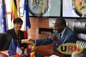 Kasaija and Rivoal at the signing of the financing agreements today