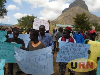 Residents of Napak with placards denouncing Minister Butime border declaration.