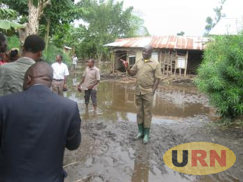 Minister, Musa Ecweru at one of the staff quarters destroyed by the floods